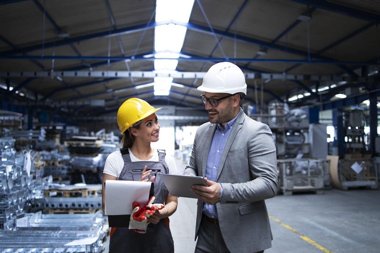 manager-supervisor-worker-discussing-about-production-results-new-strategy-factory-industrial-hall-min-1.jpg